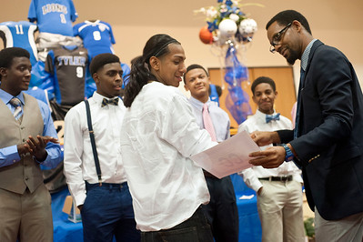 Boys cross country coach James Mosely gives an award to senior Aaron Alonso during the John Tyler High School sports banquet Thursday night at St. Louis Baptist Church in Tyler.  (photo by Sarah A. Miller/Tyler Morning Telegraph)