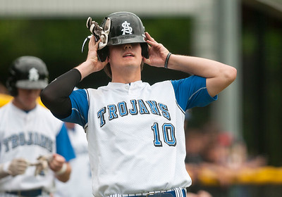 photo by Sarah A. Miller/Tyler Morning Telegraph   All Saint's (10) Parker Towns puts on his helmet as he prepares to bat during their baseball game at home Thursday against The Brook Hill School.