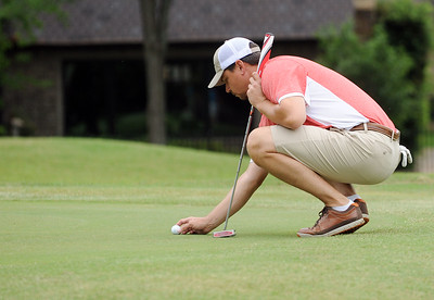 photo by Sarah A. Miller/Tyler Morning Telegraph  Jason Clark lines up his putt on the seventh green Friday during round one of the 31st Annual Azalea Invitational at Hollytree Country Club.
