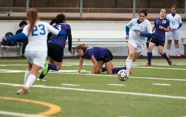 photo by Sarah A. Miller/Tyler Morning Telegraph  John Tyler's (21) Rebecca Ontiveros chases the ball as Lufkin's (17) Suzy Reyes takes a fall during their game against Lufkin at Trinity Mother Frances Rose Stadium Friday night.