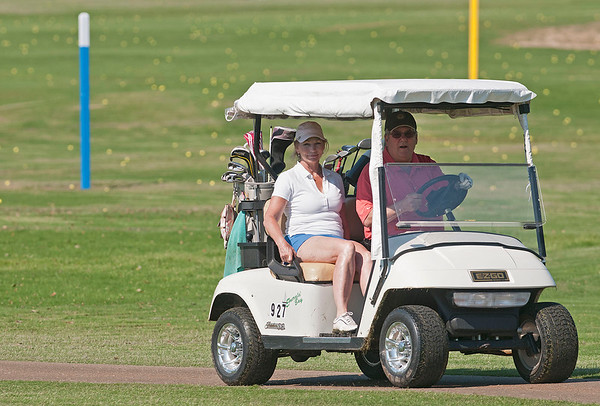 Deborah and Bruce Mote of San Antonio drive their golf cart to the 12th green during the Paradise Golf Tournament held Saturday at Emerald Bay Club in Bullard.   (photo by Sarah A. Miller/Tyler Morning Telegraph)
