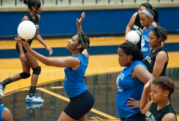 photo by Sarah A. Miller/Tyler Morning Telegraph  John Tyler High School varsity volleyball senior Ja'Liah Evans serves the ball during their first practice of the year Monday August 4, 2014 at their school gymnasium.