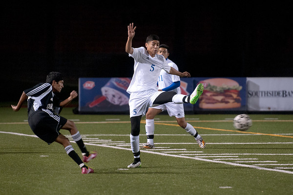 photo by Sarah A. Miller/Tyler Morning Telegraph  John Tyler's (5) Aaron Alfaro kicks the ball during the District 16-5A boys soccer match between John Tyler High School and Nacogdoches Friday night at Trinity Mother Frances Rose Stadium in Tyler.
