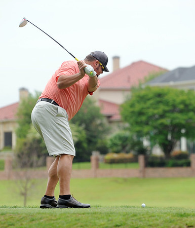 photo by Sarah A. Miller/Tyler Morning Telegraph  Mike Schrade swings on the fifth tee Friday during round one of the 31st Annual Azalea Invitational at Hollytree Country Club.
