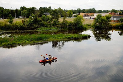 in-this-monday-aug-14-2017-file-photo-a-couple-kayak-on-the-rogue-river-adjacent-to-where-wolverine-world-wides-tannery-once-stood-in-rockford-mich-the-michigan-department-of-environmental-q