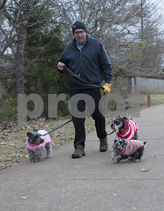 stephen-bishop-of-tyler-takes-three-sweaterwearing-dogs-on-a-walk-at-the-rose-rudman-trail-in-tyler-texas-on-friday-morning-dec-29-2017-the-temperatures-are-expected-to-drop-in-east-texas-go