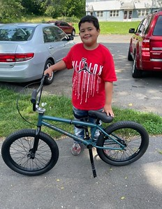 new-britain-student-receives-brand-new-bike-as-part-of-nutmeg-big-brothers-big-sisters-mentoring-program
