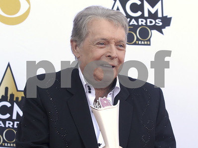 in-this-april-19-2015-file-photo-mickey-gilley-poses-with-the-triple-crown-award-on-the-red-carpet-at-the-50th-annual-academy-of-country-music-awards-at-att-stadium-in-arlington-texas-countr