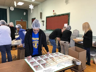 rotary-clubs-join-together-to-pack-meals-for-haiti