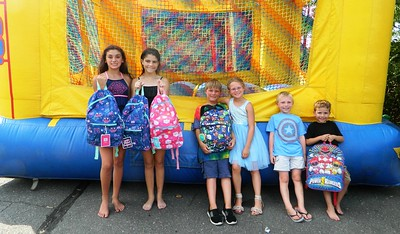 church-delivers-school-supplies-at-backpack-giveaway