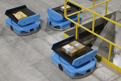 as-robots-take-over-warehousing-workers-pushed-to-adapt