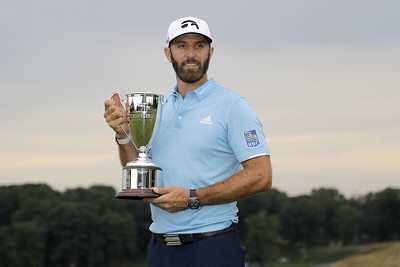 johnson-hangs-on-in-final-round-wins-travelers-championship