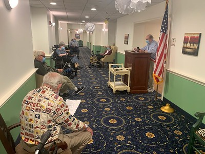 group-of-seniors-at-middlewoods-including-two-army-vets-celebrate-american-flag