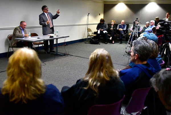 10/11/2016 Mike Orazzi | Staff State senator Henri Martin and state senate candidate Mike Nicastro during Tuesday evening's debate held at the Plainville Library.