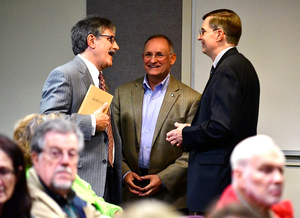 10/11/2016 Mike Orazzi | Staff State senate candidate Mike Nicastro talks with state senator Henri Martin talks with moderator Richard Williams before Tuesday evenings debate held at the Plainville Library.
