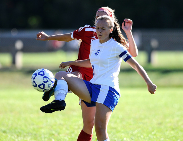 10/11/2016 Mike Orazzi | Staff Berlin's Julia Sisti (3) and Bristol Eastern's Emily Stadnicki (10) during Tuesday's soccer match in Bristol.