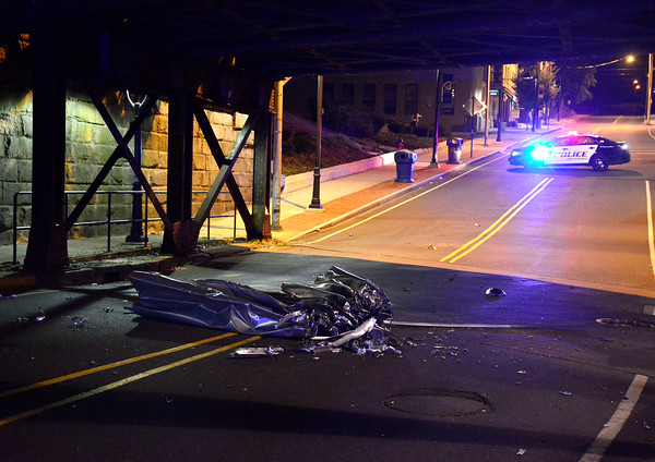 10/11/2016 Mike Orazzi | Staff The top portion of a box truck that was too high for the railroad underpass on Main Street Tuesday night. The truck and driver fled the scene and the street remained closed for a several hours.