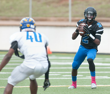 John Tyler's Bryson Smith looks for his pass during the first half of their game against Jacksonville at Trinity Mother Francis Rose Stadium in Tyler Saturday afternoon Oct. 31, 2015.   (Sarah A. Miller/Tyler Morning Telegraph)