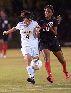 Tyler Junior College's Kie Asai kicks the ball away from Navarro College's Tiffany Robinson in the first half of their game at home Tuesday night.  (Sarah A. Miller/Tyler Morning Telegraph)