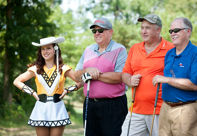 Tyler Junior College Apache Belle Madison Loewen poses for a photo with golfers Ed Flowers of Tyler, Robert Mitchell of Pritchett and Tim Shaughmessy of Longview at the Azalea Orthopedics Scholarship Golf Tournament Benefitting the TJC Foundation Thursday at Hollytree Country Club in Tyler.   (Sarah A. Miller/Tyler Morning Telegraph)