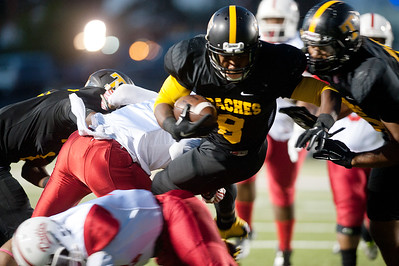 Tyler Junior College's Ken Burks is tripped up as they play Texas Institute of Agriculture and Technology Saturday night at Trinity Mother Frances Rose Stadium.  (Sarah A. Miller/Tyler Morning Telegraph)