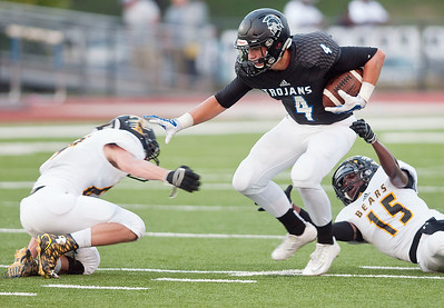 Timpson's James Moore (64), left, and TJ Thompson (15), right, try to stop All Saints Episcopal School's Logan Bradford (4) Saturday night during their game against Timpson in the 10th annual Azalea Orthopedics and Texas Spine and Joint Hospital Tyler Football Classic.  (Sarah A. Miller/Tyler Morning Telegraph)