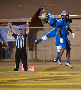 Jacksonville's J'mofrick Taylor (23) celebrates with Tradarrious Wagoner after Wagoner scored a touchdown Friday night during their game against Corsicana at the Tomato Bowl.  (Sarah A. Miller/Tyler Morning Telegraph)