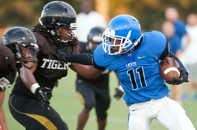 John Tyler's Kieran Freeman (11) carries the ball as they play Mount Pleasant during a scrimmage Friday night at John Tyler High School.  (Sarah A. Miller/Tyler Morning Telegraph)