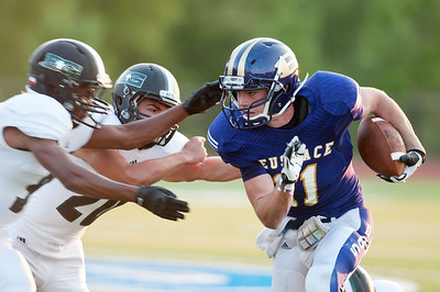 Bishop T.K. Gorman football player Blake Johnson (16) and Matthew Chaump (20) work to stop Eustace's Micah Stone (11)  during their game at All Saints Episcopal School Friday night Aug. 28, 2015. The game was part of the Azalea Orthopedics and Texas Spine and Joint Hospital Football Classic.  (Sarah A. Miller/Tyler Morning Telegraph)