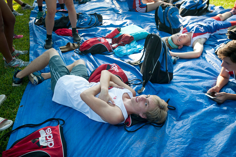Bullard senior Brady Moore rests with teammates before their race at the Tyler Lee Cross County Classic held Saturday morning at the University of Texas at Tyler.   (Sarah A. Miller/Tyler Morning Telegraph)
