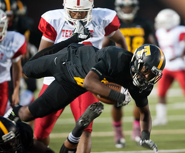 Tyler Junior College's Ryan Parker is tripped up as they play Texas Institute of Agriculture and Technology Saturday night at Trinity Mother Frances Rose Stadium.  (Sarah A. Miller/Tyler Morning Telegraph)