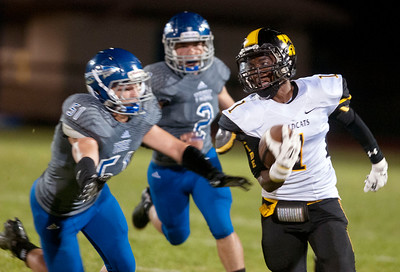 Winona's Quaylon Brown runs past Frankston's Drew Lewis (51) during their game Friday night in Frankston.  (Sarah A. Miller/Tyler Morning Telegraph)