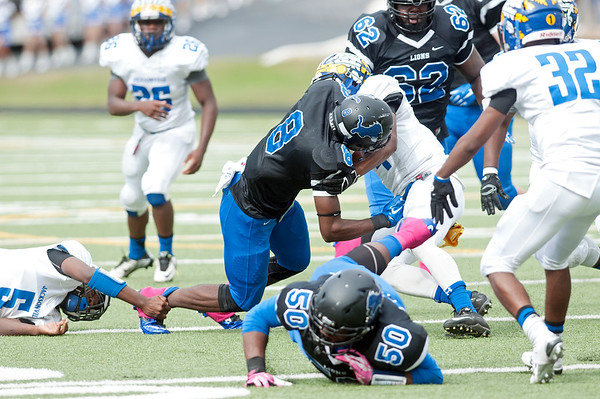 John Tyler's (8) Damion Miller is tripped up during the first half of their game against Jacksonville at Trinity Mother Francis Rose Stadium in Tyler Saturday afternoon Oct. 31, 2015.   (Sarah A. Miller/Tyler Morning Telegraph)
