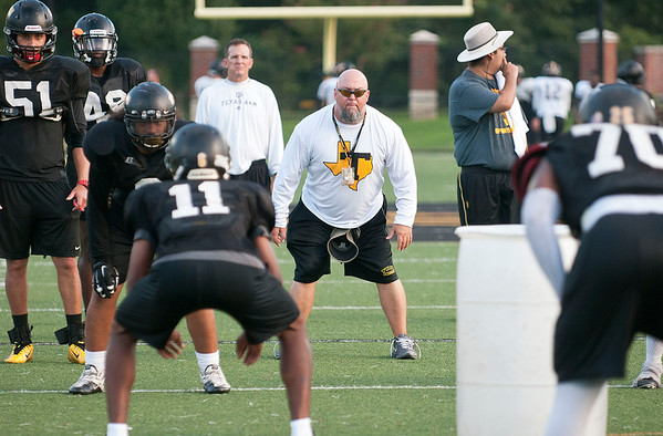 Tyler Junior College football team defensive coordinator Russell Thompson runs a drill during practice Tuesday evening at Pat Hartley Field.  (Sarah A. Miller/Tyler Morning Telegraph)