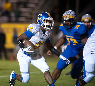 Corsicana's Ja'Micha Polk carries the all Friday night during their game against Jacksonville at the Tomato Bowl.  (Sarah A. Miller/Tyler Morning Telegraph)