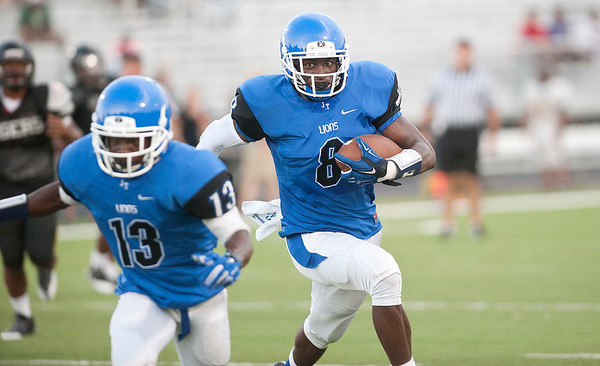 John Tyler's Damion Miller (8) gains yards during a scrimmage against Mount Pleasant Friday night at John Tyler High School.  (Sarah A. Miller/Tyler Morning Telegraph)