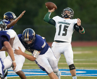 Bishop T.K. Gorman football player Michael Goodwin looks to make a pass during their game against Eustace at All Saints Episcopal School Friday night Aug. 28, 2015. The game was part of the Azalea Orthopedics and Texas Spine and Joint Hospital Football Classic.  (Sarah A. Miller/Tyler Morning Telegraph)