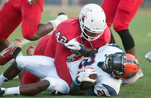 Trinity Valley Community College's Jonathan Taylor (42) tackles Nassau Community College's Quentin America at Bruce Field in Athens Saturday night.  (Sarah A. Miller/Tyler Morning Telegraph)