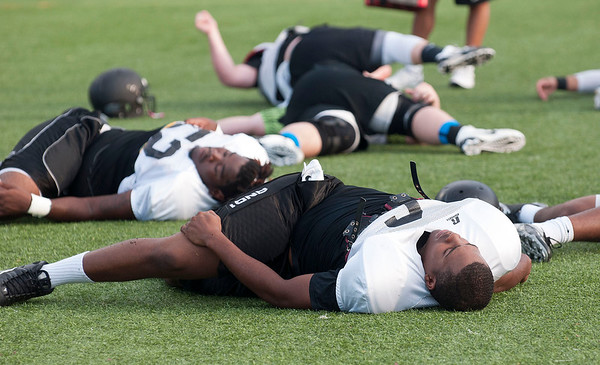 Tyler Junior College football team players stretch during practice Tuesday evening at Pat Hartley Field.  (Sarah A. Miller/Tyler Morning Telegraph)