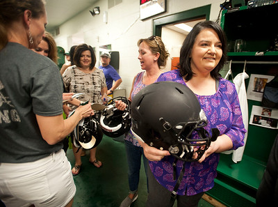 Stacey Chiasson holds her son Robbie's football helmet as she waits inside the football field house Wednesday Aug. 26, 2015 to decorate the helmet with school decals for the team's first game Friday night. The Chiasson family evacuated to Tyler during Hurricane Katrina 10 years ago this week.  (Sarah A. Miller/Tyler Morning Telegraph)