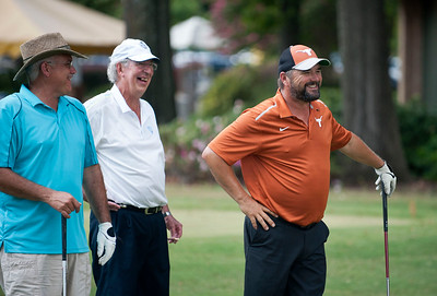 Tommy Richmond, Roger Lowery and James McGuire wait for their turn on the 10th hole at the Azalea Orthopedics Scholarship Golf Tournament Benefitting the TJC Foundation Thursday at Hollytree Country Club in Tyler.   (Sarah A. Miller/Tyler Morning Telegraph)