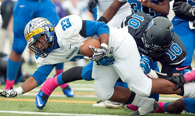 John Tyler's (10) Gregorio Guerrero tackles Jacksonville's (23) J'modrick Taylor during the first half of their game at Trinity Mother Francis Rose Stadium in Tyler Saturday afternoon Oct. 31, 2015.   (Sarah A. Miller/Tyler Morning Telegraph)