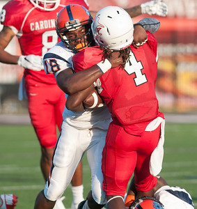 Trinity Valley Community College's Emmanuel Harris (4) is taken down by Nassau Community College's Deon Wright (18) at Bruce Field in Athens Saturday night.  (Sarah A. Miller/Tyler Morning Telegraph)